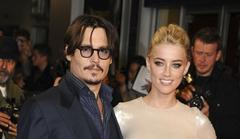 johnny depp dating amber heard again? spotted at stones concert
